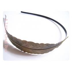 1 serre tête à plume -  bronze