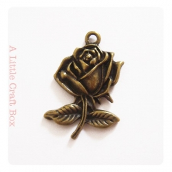 "1 breloque ""rose sur branche"" -  bronze"