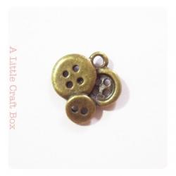 "2 breloques  ""boutons"" - bronze"