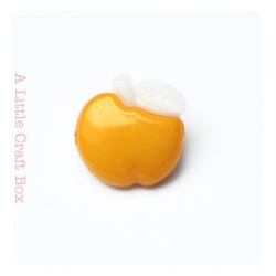 "1 bouton ""pomme"" - jaune poussin"