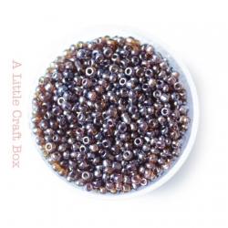 20g de perles de rocaille 2mm - café irisé transparent