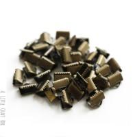 [ GROS LOT ] 100 griffes 10x8mm - bronze